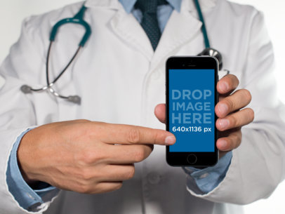 Mockup of a Male Doctor Showing an iPhone in Portrait Mode 12404