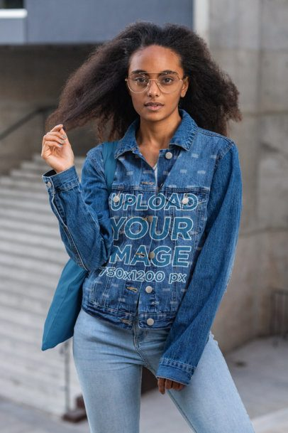 Denim Jacket Mockup of a Young Woman Touching Her Hair 32584