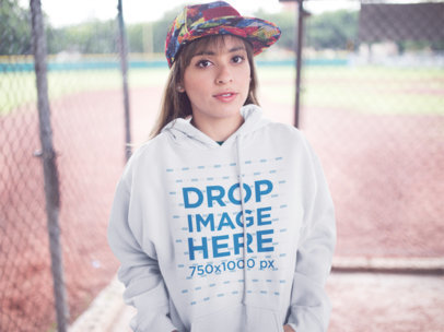 Hoodie Mockup of a Young Hispanic Girl Wearing a Hat a12454