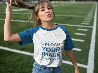 Flirty Young Girl Wearing a Raglan Tee at a Football Field a12476a