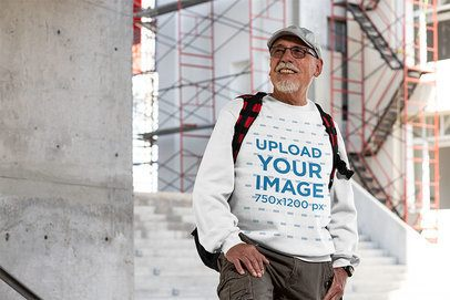 Crewneck Sweatshirt Mockup Featuring a Senior Man by a Construction Site 32880