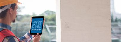 Black iPad Mini Mockup of a Civil Engineer Working a12429wide