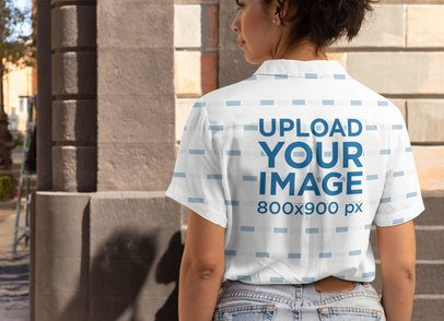 Back View Mockup Featuring a Woman Wearing a Button-Up Shirt in the City 33126
