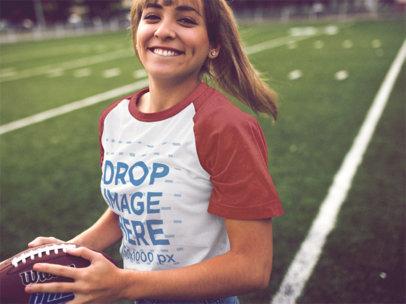 Raglan T-Shirt Mockup of a Girl Playing on a Football Field 12477a