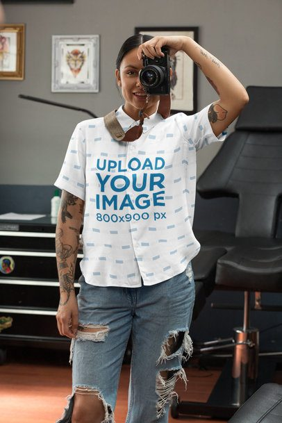 Button up Shirt Mockup Featuring a Woman Taking a Picture With a Vintage Camera 33148