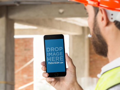 Black iPhone 6 Mockup of a Construction Worker on Site a12423