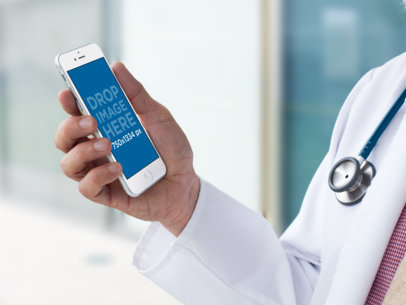 Mockup of a Doctor's Hand Holding an iPhone 12438