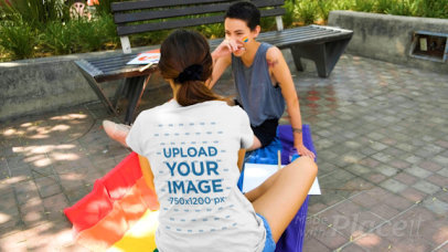Back View T-Shirt Video Featuring a Woman Sitting on an LGBTQ Flag 33365
