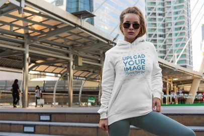 Hoodie Mockup of a Woman Posing in Front of a City Landscape 3556-el1