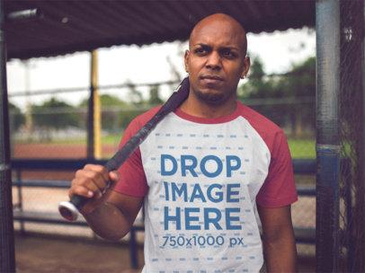 Black Man Playing Baseball and Wearing a Raglan T-Shirt Mockup a12471