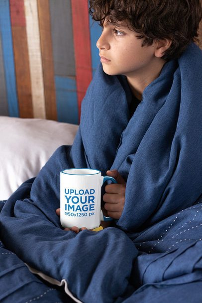 15 oz Colored Rim Mug Mockup of a Boy Covered with a Quilt 33169