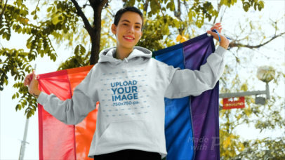 Hoodie Mockup of a Woman with a Pride Flag Painted on Her Face 33378