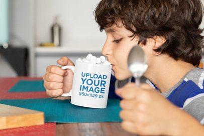11 oz Mug Mockup of a Kid Having Hot Cocoa with Marshmallows 33162