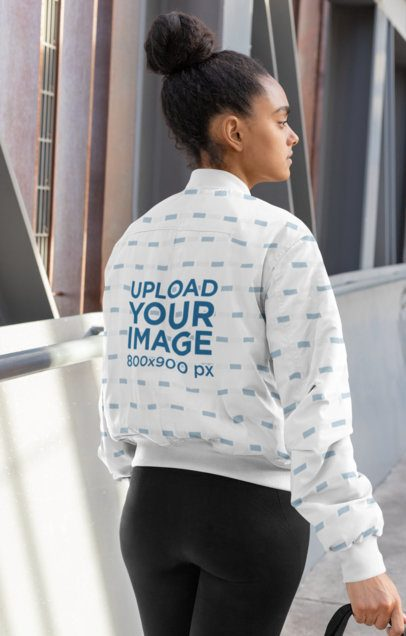 Back-View Mockup of a Woman Wearing a Bomber Jacket 33225