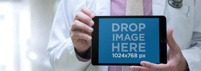 iPad Mini in Landscape View Held by a Senior Doctor a12447wide