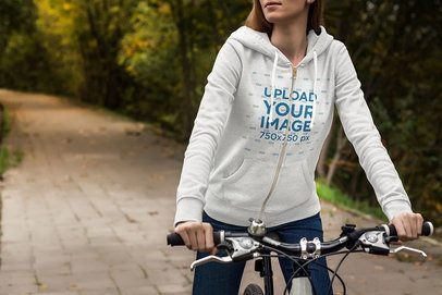 Heather Hoodie Mockup of a Woman Riding a Bicycle 3564-el1