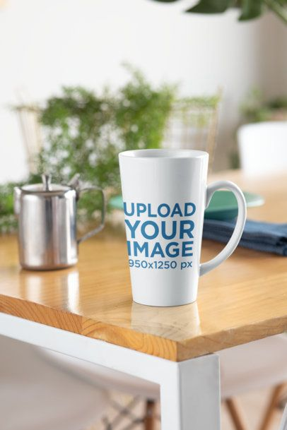 Mockup of a 15 oz Coffee Mug Placed on a Modern Wooden Table 33196