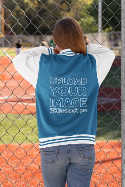 Mockup of a Young Woman with a Varsity Jacket Watching a Baseball Game 33208