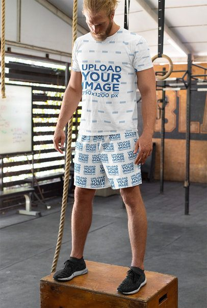 T-Shirt and Shorts Mockup of a Man at the Gym 33060