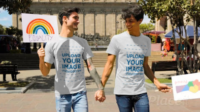 Video of a Couple with T-Shirts Holding Hands at the Pride Parade 33353