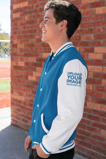Sleeve Mockup of a Happy Young Man Wearing a Varsity Jacket 33215