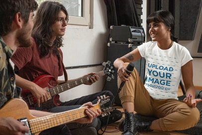T-Shirt Mockup Featuring a Female Singer Practicing With Her Music Band 33343