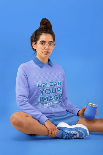 Sweatshirt Mockup of a Woman Sitting on the Floor in a Studio 32821