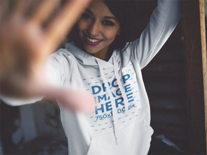 Trendy Girl Wearing a Hoodie Mockup Playing Around b12488