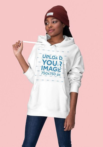 Mockup of a Sassy Young Woman Wearing a Hoodie at a Studio 1819-el1