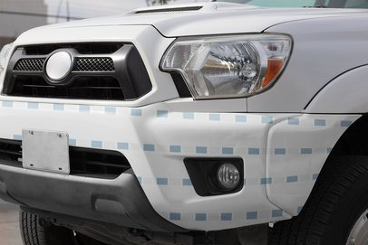 Car Decal Mockup Placed on a Pickup Truck's Front Bumper 33237