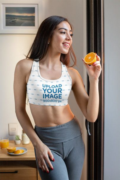 Sports Bra Mockup Featuring a Woman Eating an Orange 32756