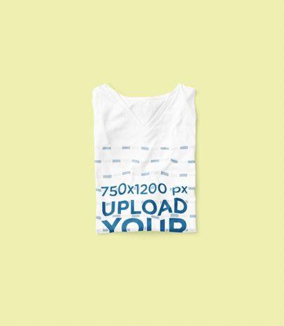 Mockup of a Folded V-Neck T-Shirt Placed Over a Plain Color Background 3670-el1