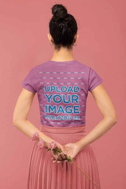Back View T-Shirt Mockup Featuring a Woman Holding Some Flowers in a Monochromatic Setting 32785