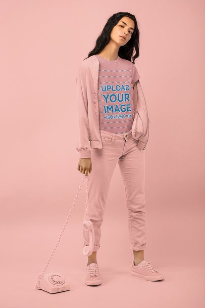 T-Shirt Mockup of a Woman Holding a Vintage Telephone at a Studio 32783
