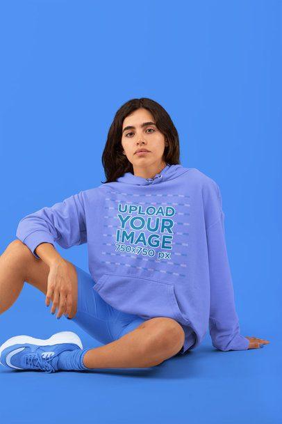 Monochromatic Sweatshirt Mockup Featuring a Woman Sitting in a Studio 32819