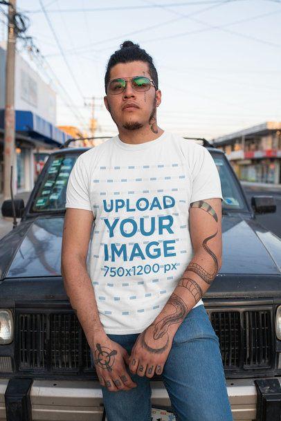 T-Shirt Mockup of a Tattooed Man Posing on the Street 32820