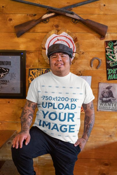 T-Shirt Mockup Featuring a Happy Man With Tattoos Posing at a Bar 32853