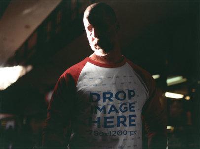 Man Wearing a Raglan T-Shirt Mockup in a Shadow b12626