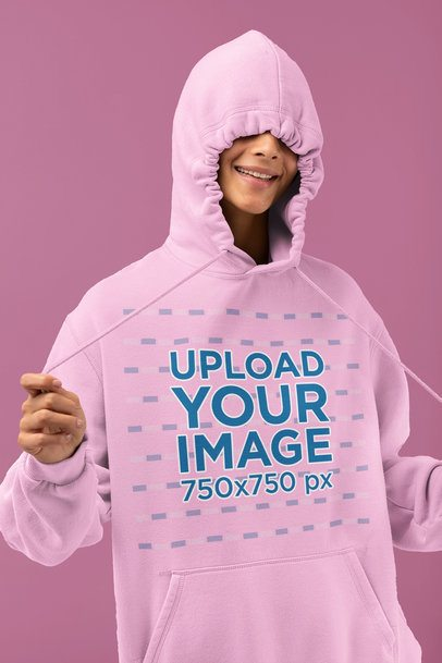Hoodie Mockup Featuring a Woman Doing a Silly Pose in a Studio 32791