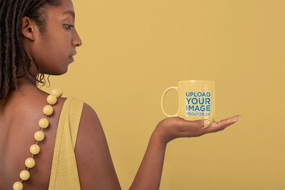 Mockup of a Woman Carefully Holding a Coffee Mug 32812