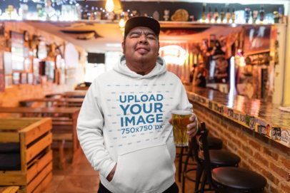 Hoodie Mockup of a Man Drinking an Ale at a Rustic Bar 32859