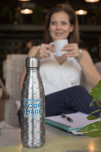 Aluminum Bottle Mockup Featuring a Middle-Aged Woman in the Background 33483