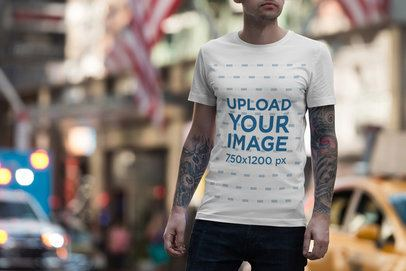T-Shirt Mockup Featuring a Tattooed Man on a Busy Street 1954-el1
