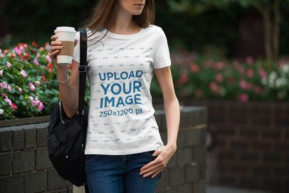 T-Shirt Mockup of a Woman with a Coffee To-Go in Her Hand 1957-el1