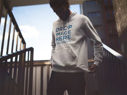 Pullover Hoodie Mockup of a Young Man with Long Hair and Beard Walking Down the Stairs 12599