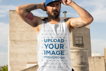 Tank top Mockup of a Man with Tattoos Standing by an Abandoned Building 32842