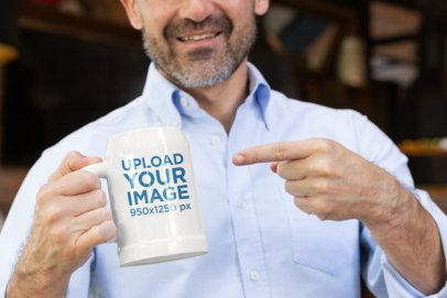 Mockup of a Man Pointing at His Beer Mug 33444