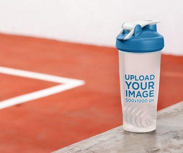 Blender Bottle Mockup Placed Against an Indoor Sports Court 33676