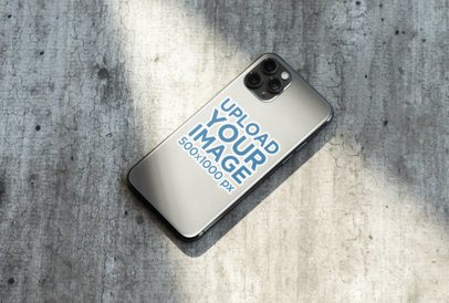 Sticker Mockup of an iPhone 11 Pro Placed on a Solid Surface 33601