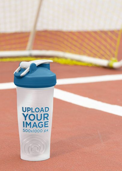 Mockup of a Shaker Bottle Placed by a Soccer Goal 33673